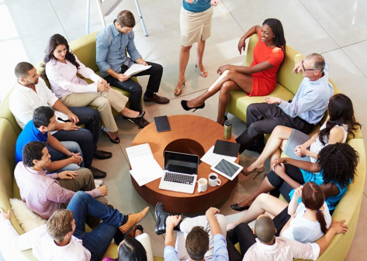 Businesswoman making presentation to colleagues - Executive Lounge Conversations